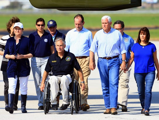 Vice President Mike Pence walks with Texas Governor