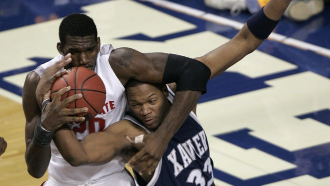 Ohio State's Greg Oden,  left, and Xavier's Brandon Cole battle for a rebound in the NCAA Tournament on March 17, 2007.