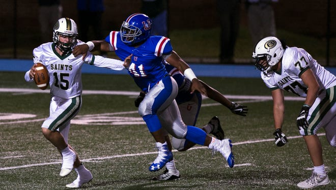 Memphis University School linebacker Dorian Hopkins (41) closes in for a sack of Briarcrest quarterback Jackson Walker.