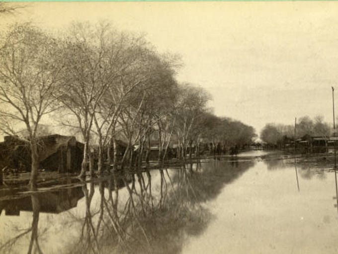 1891: Phoenix neighborhood after The Great Flood. 15