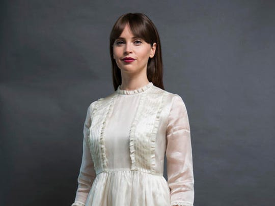 "In this Dec. 4, 2016 photo, Felicity Jones, who plays Jyn Erso in ""Rogue One: A Star Wars Story,"" poses for a photo in San Francisco."