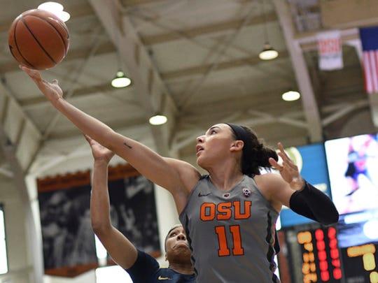 Oregon State guard Gabriella Hanson (11) shoots a layup against California during an NCAA college basketball game Sunday, Feb. 26, 2017, in Corvallis, Ore. (Anibal Ortiz/The Corvallis Gazette-Times via AP)