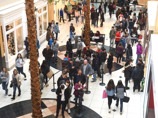 Holiday shoppers pack the Somerset Collection Mall in Troy.