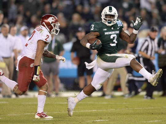 Michigan State Spartans running back LJ Scott (3) runs for a touchdown against Washington State Cougars defensive back Robert Taylor (2) during the fourth quarter in the 2017 Holiday Bowl at SDCCU Stadium.