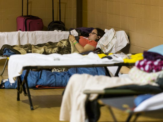 In this file photo, a homeless woman listens to music in her cot at Safe To Sleep, an overnight shelter for homeless women at Pathways United Methodist. There is no cold weather shelter for women in Springfield.