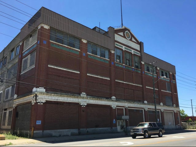 TWG plans to redevelop the old Ford Manufacturing Co. assembly plant at 1315 E. Washington St. into a mixed-use residential and retail complex.