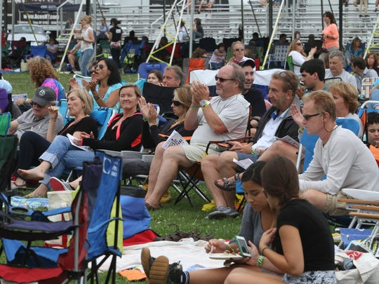 Festival goers applaud the Annie Minogue Band during the 12th annual Pleasantville Music Festival July 9, 2016.