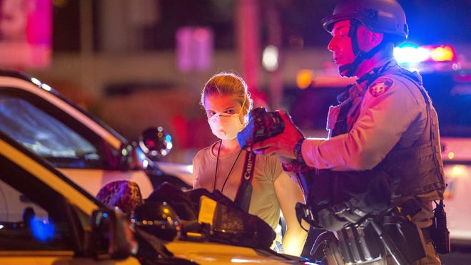 Las Vegas Review Journal staff photographer Ellen Schmidt is detained by Las Vegas Metro Police during a protest in Las Vegas on Friday. Protesters were reacting to the death of George Floyd, who died while in Minneapolis police custody.