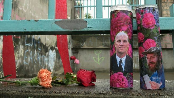 Votive candles bearing the photos of two men who were fatally stabbed on a Portland, Ore., light-train while trying to stop another man from harassing two young women with an anti-Muslim tirade.
