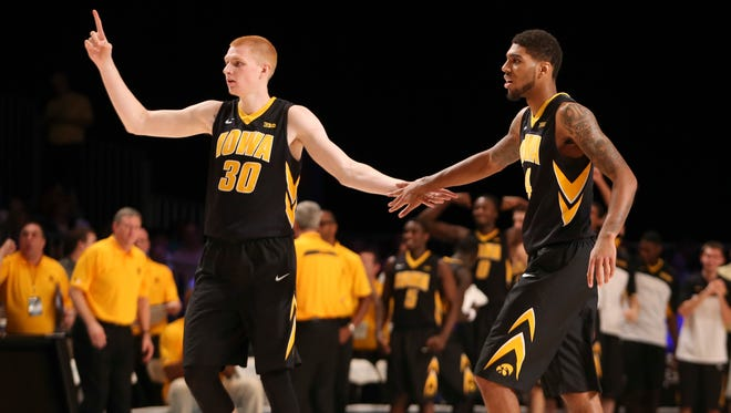 Nov 30, 2013; Paradise Island, BAHAMAS; Iowa Hawkeyes forward Aaron White (30) celebrates with guard Roy Devyn Marble (4) after a score during the first half against the Villanova Wildcats in the 2013 Battle 4 Atlantis Championship game in the Imperial Arena at the Atlantis Resort. Mandatory Credit: Kevin Jairaj-USA TODAY Sports