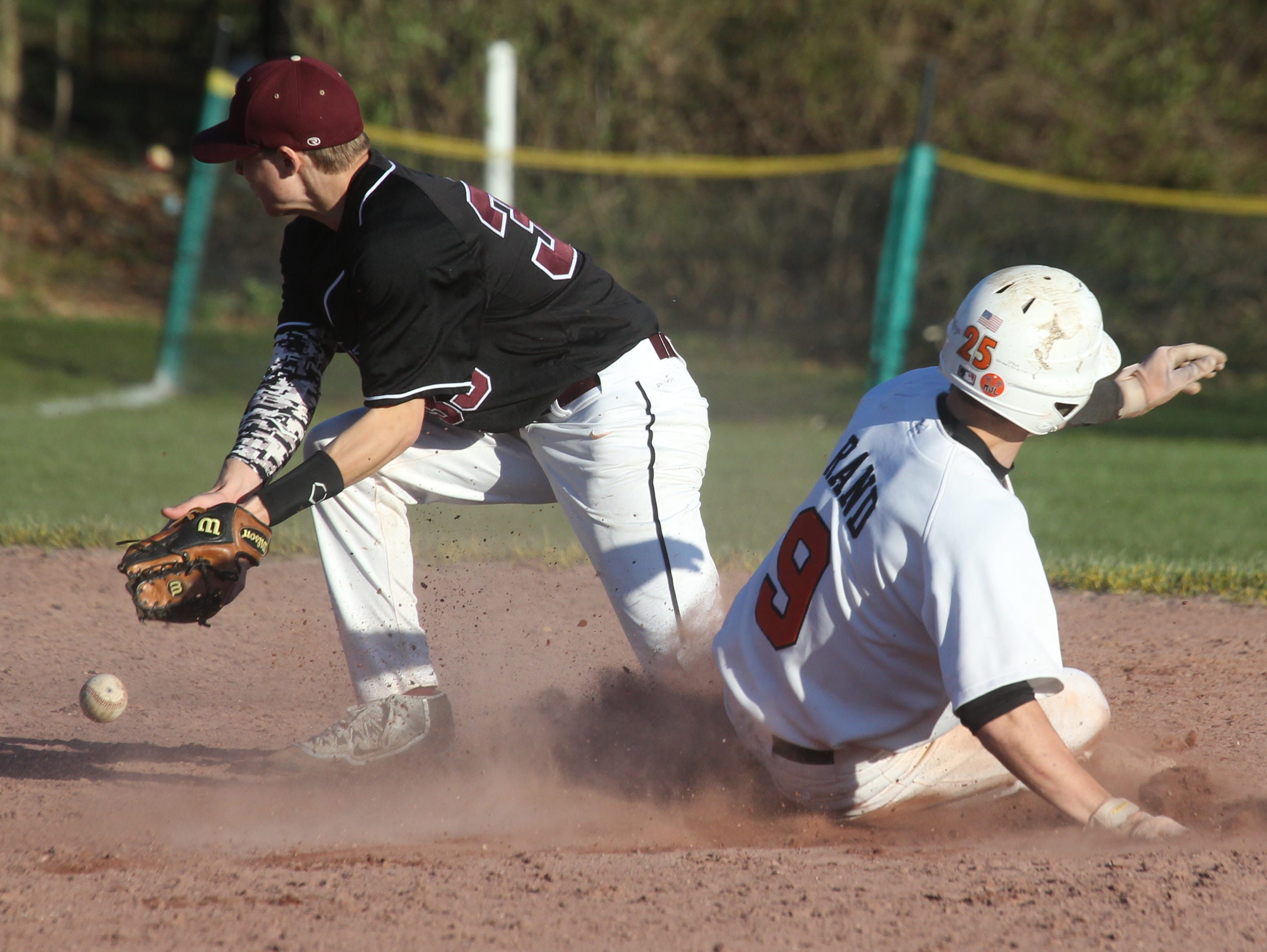 White Plains' Steven Rand steals second as the ball gets away from Scarsdale's Scott Kelly during their game at White Plains April 12, 2016. White Plains won 7-0.