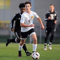 New Eisenhower senior Brandon Dombrowski pushes the ball up field during a soccer match between New Berlin Eisenhower and Wauwatosa West at Whitman Middle School in Wauwatosa Monday, Sept. 26.