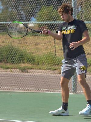 Pueblo County High School's Dean DeCarlo returns a serve against Pueblo East's Ian Imes on Tuesday, Aug. 18, 2020, on the courts at Pueblo County High School.
