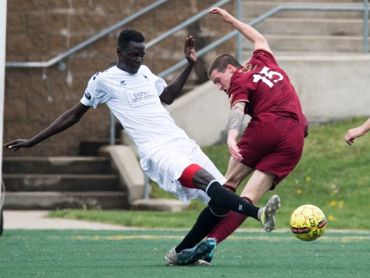 DCFC's Josh Gatt closes down on an AFC Ann Arbor ball