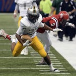 Calvary's Kyle Jones runs for a first down against Catholic High during fourth quarter action of the LHSAA Division III finals between Calvary Baptist and Catholic High last December at the Mercedes-Benz Superdome in New Orleans.