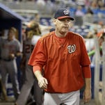 In this photo taken Sept. 13, 2015, Washington Nationals manager Matt Williams walks in the dugout during a baseball game against the Miami Marlins in Miami. The Washington Nationals say they have fired Matt Williams and his coaching staff. (AP Photo/Lynne Sladky)