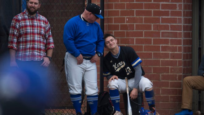 Karn's Ryder Green (22) shares a moment with one of his coaches at a high school baseball game between Karns and Campbell County Thursday, April 5, 2018. Karns defeated Campbell County.