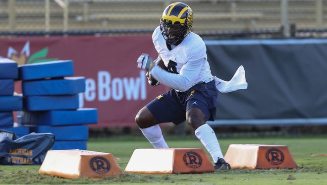 Michigan Wolverines' De'Veon Smith goes through drills during practice for the upcoming Orange Bowl against Florida State on Tuesday, December 27, 2016 at Barry University in Miami Shores, Fla.