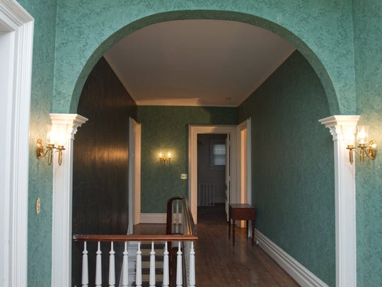 An arch in the upstairs hallway adds a subtle separation