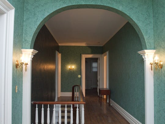 An arch in the upstairs hallway adds a subtle separation for what might have been a sitting area.