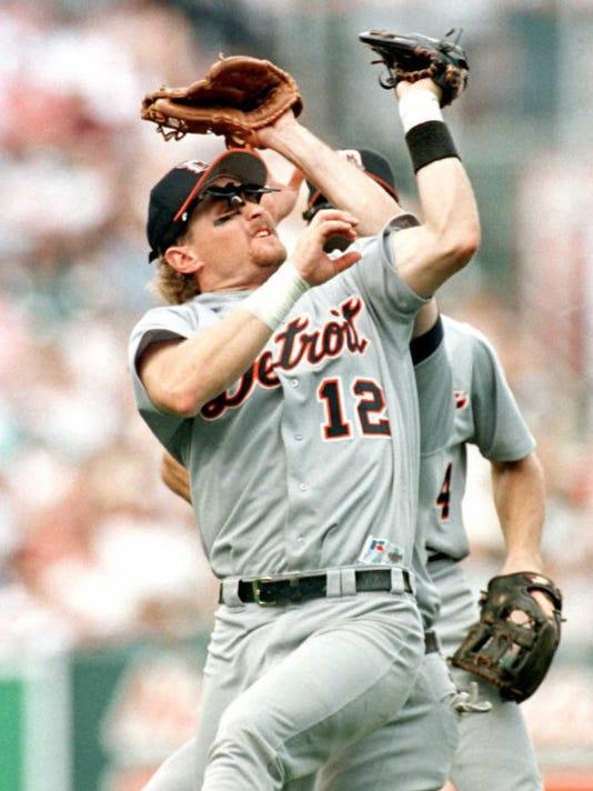 Detroit Tigers' third baseman Phil Nevin (12) grim