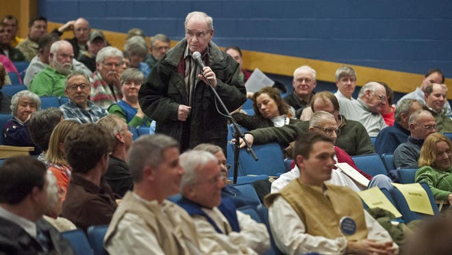 Lefty Guillette speaks in favor of funding the town Memorial Day parade during the Essex town meeting on Monday, March 4, 2013.