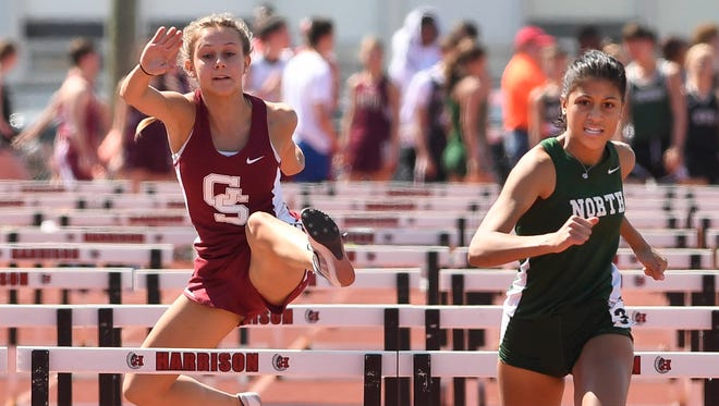 Gibson Southern's Sammi Bittner (left) and North's Ariah Leary compete in the girls 100 meter hurdles during the Indiana/Kentucky Track Challenge held at Evansville's Harrison High School Saturday, April 15, 2017.