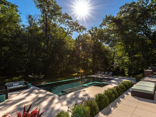 Cipriano Landscape Design & Custom Pools created this Saddle River backyard.