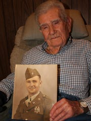 R.B. Stabler of Greenville holds a photo of how he