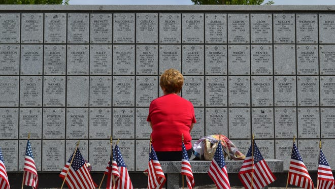 A woman sits during at the Northern Nevada Columbarium during Memorial Day 2014.