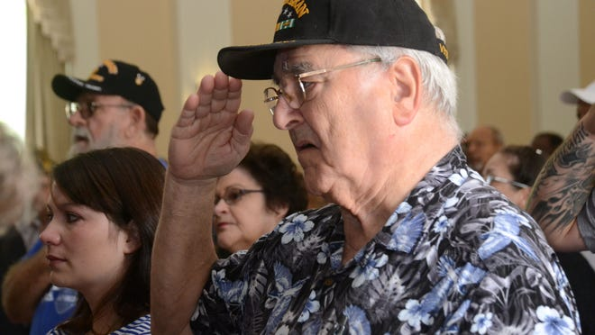 """Paul Benoit, a Vietnam veteran who served in the U.S. Army from 1957-1979, salutes during the playing of the """"National Anthem"""" as it plays at the Alexandria VA Health Care System Memorial Day Program held Monday at the VA Medical Center. The program was moved from Alexandria National Cemetery to the VA Medical Center due to threat of rain."""