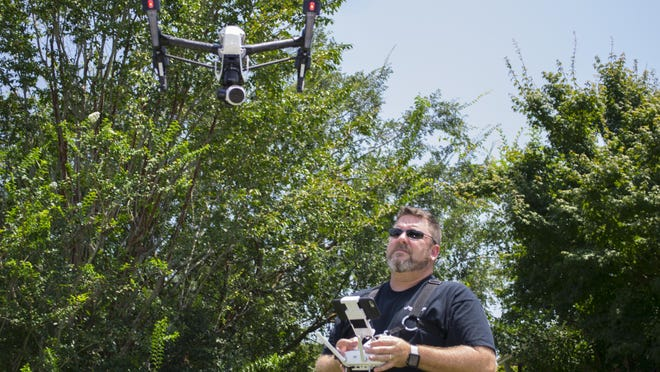 Richard Simpson pilots a drone for his company, Hover Check Aerial Productions, which specializes in drone-powered aerial photography and videography.