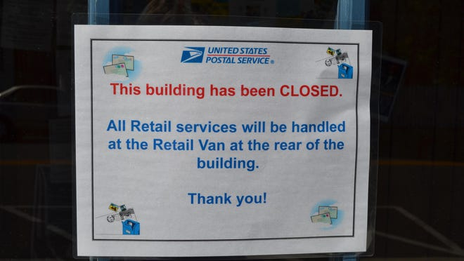 This sign has been posted on the front door of the Princess Anne Post Office announcing that the building is closed.
