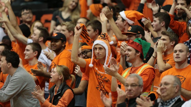 Dec 5, 2015; Corvallis, OR, USA; Oregon State Beavers fans celebrate against the Nevada Wolf Pack at Gill Coliseum. Mandatory Credit: Scott Olmos-USA TODAY Sports