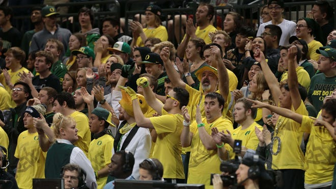 Jan 10, 2016; Eugene, OR, USA; Oregon Ducks fans cheer against the Stanford Cardinal at Matthew Knight Arena. Mandatory Credit: Scott Olmos-USA TODAY Sports