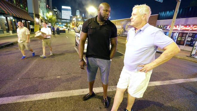 June 11, 2016-  10:32 PM - Memphis City Councilman Berlin Boyd, on left, and Memphis real estate investor Charley Ryan check on the 2016 launch of Beale Street Bucks.