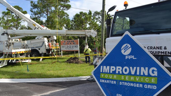 A Florida Power & Light crew replaces wooden poles with concrete ones in Palm Beach County.