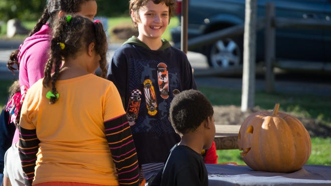 Kids talk to the talking pumpkin at Shelby City Park's 2019 Halloween event. For 2020 the City Park with hold a socially distanced drive-in double feature movie on Friday night.