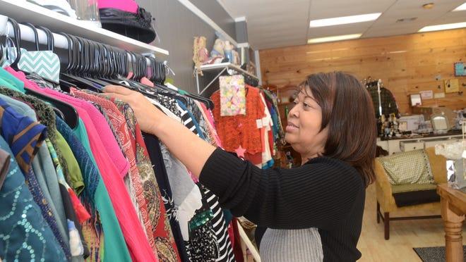 ANI Shopping Friday Joann Swain, owner of Lue'Netta's Closet on Jackson Street, is hopeful for the holiday season. Friday, Nov. 28, 2014. -Melinda Martinez/mmartinez@thetowntalk.com, The Town Talk, Gannett