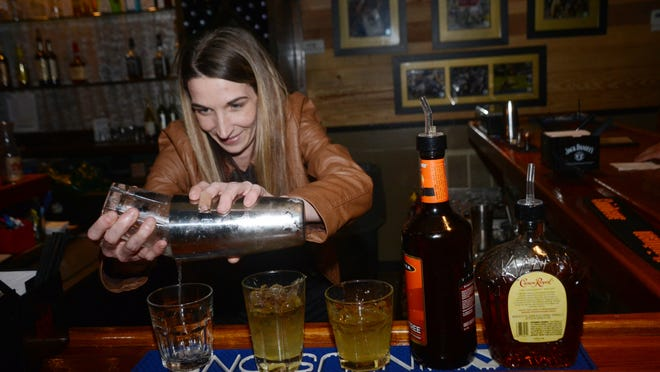 Nikki White, a bartender at Poppa T's Oyster House and Grill on Highway 28 East in Pineville, mixes up some drinks Friday, Jan. 30, 2015.-Melinda Martinez/mmartinez@thetowntalk.com The Town Talk Gannett