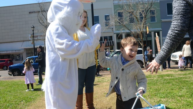 Paxton Hill, 3, (left), high-fives the Easter Bunny. The YWCA hosted a Breakfast with the Bunny event at The Gem in downtown Alexandria Saturday, March 7, 2015 That included an Easter egg hunt, a ride on Choo-Choo Alex and a McDonald's breakfast with the Easter Bunny. Proceeds from the event benefit the YWCA programs.
