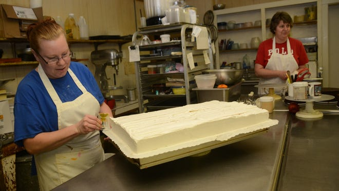Ashley Terracina (left) and Dawn Ramo are cake decorators at Harlow's Donut & Bakery. Terracina has been with the Pineville establishment for a year and Ramo worked there for about five years.