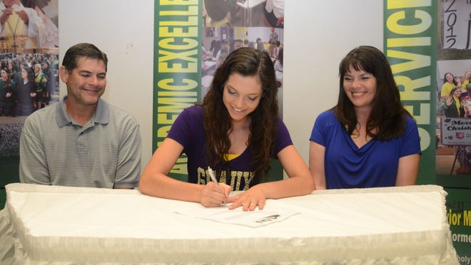 Menard's Mallory Robichaux (center) is flanked by her parents Kevin and Stephanie Robichaux Friday morning as she signs scholarship papers to run track at LSU.