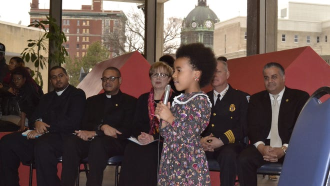 "Brianna Daniels, 7, of Binghamton, leads the crowd in singing ""We Shall Overcome"" during the annual NAACP Martin Luther King Jr. Day celebration in City Hall on Monday."