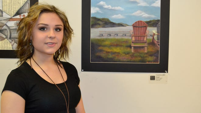 """Vestal High School senior Brooke Angelo's painting, Purple, won the composition award in the """"An Artistic Discovery"""" Congressional High School Art Competition for Broome County."""