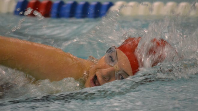 Canton's Jane Benson swims during a recent meet. She and her teammates continue to parlay strong numbers per event into wins.