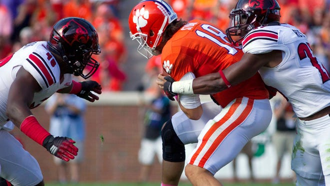 Clemson quarterback Cole Stoudt is sacked by U of L safety Jermaine Reve (27) during the first half of last Saturday's game at Memorial Stadium.