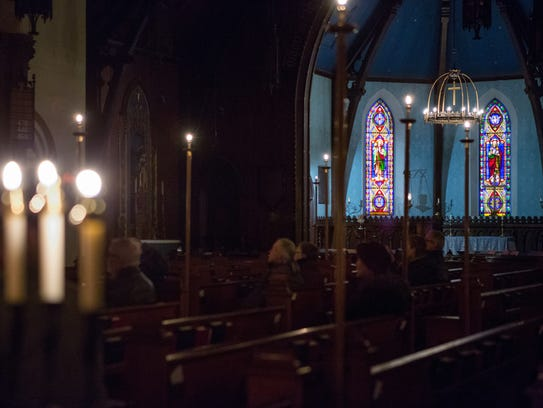 The church is lit only by candlelight during compline.