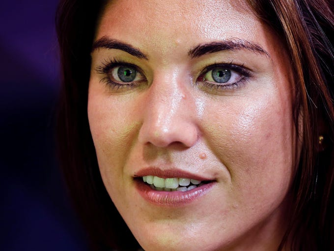 United States goalkeeper Hope Solo speaks to reporters following the team's gold medal win at the 2012 Summer Olympics.