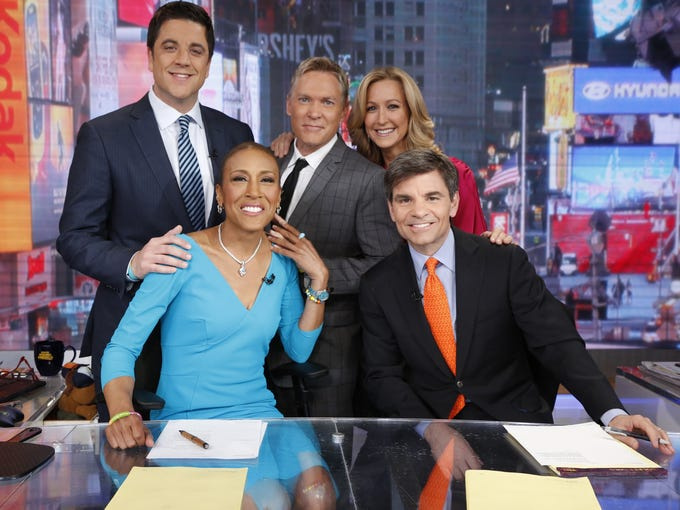 """""""I have been waiting 174 days to say this,"""" noted Robin Roberts on Wednesday morning. """"The 'Good Morning America' anchor was welcomed back to work five months after a bone-marrow transplant for a rare blood disorder. News anchor Josh Elliott, left, weatherman Sam Champion, lifestyle editor Lara  Spencer, Roberts and co-host George Stephanopoulos celebrated their reunion."""